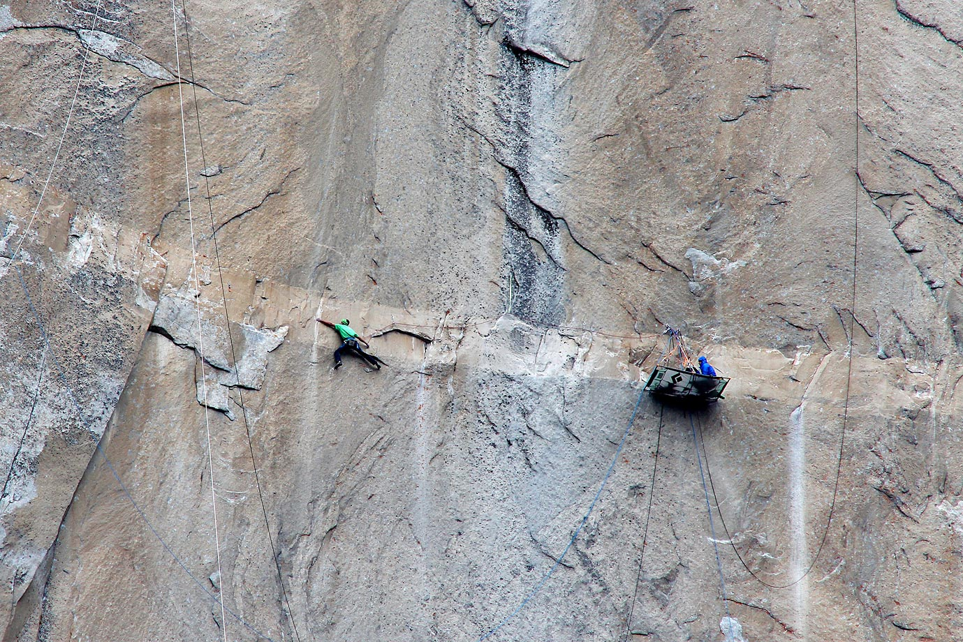 Kevin Jorgeson (in green) climbing on Pitch 15 while Tommy Caldwell belays.
