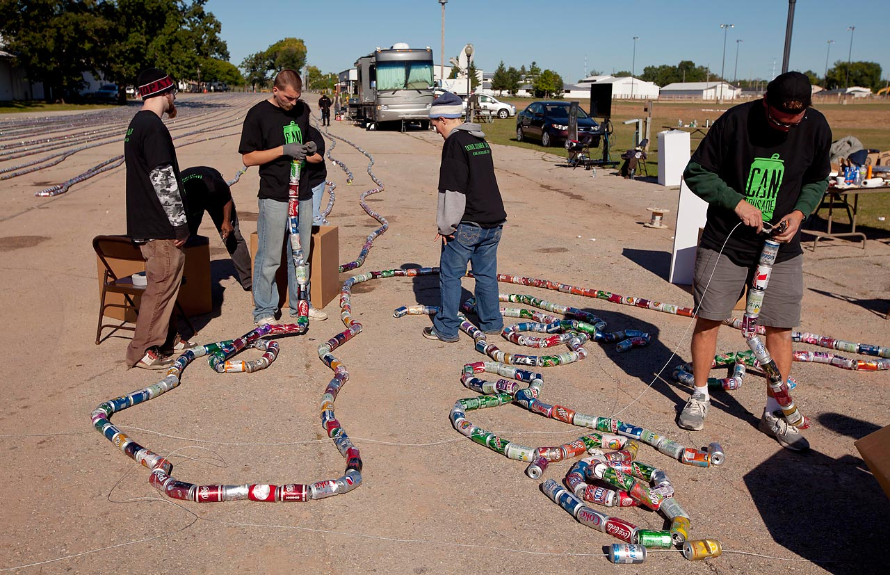 The Aluminum Association in De Pere, Wis., set the record with 66,343 cans strung together. The chain was over five miles long.