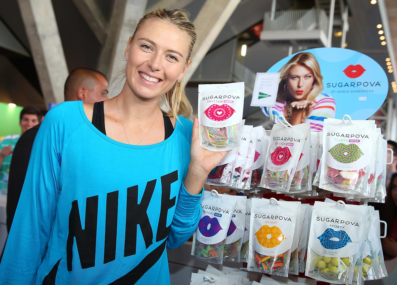 Sharapova poses at the Sugarpova stand during the Mutua Madrid Open tournament in May 2013.