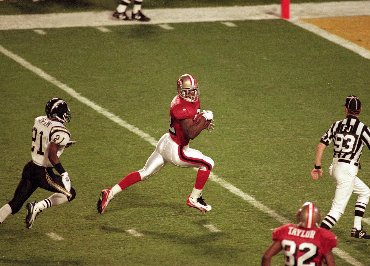 San Francisco 49ers running back Ricky Watters outpaces San Diego Chargers cornerback Darrien Gordon on a 51-yard touchdown pass from quarterback Steve Young. Watters scored three touchdowns in the Niners' 49-26 win, catching two and rushing for a third.