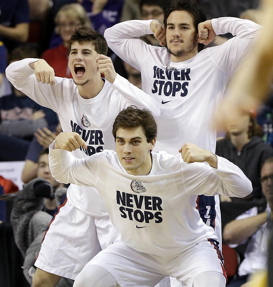 Gonzaga players react from the bench after their team scored against Iowa.