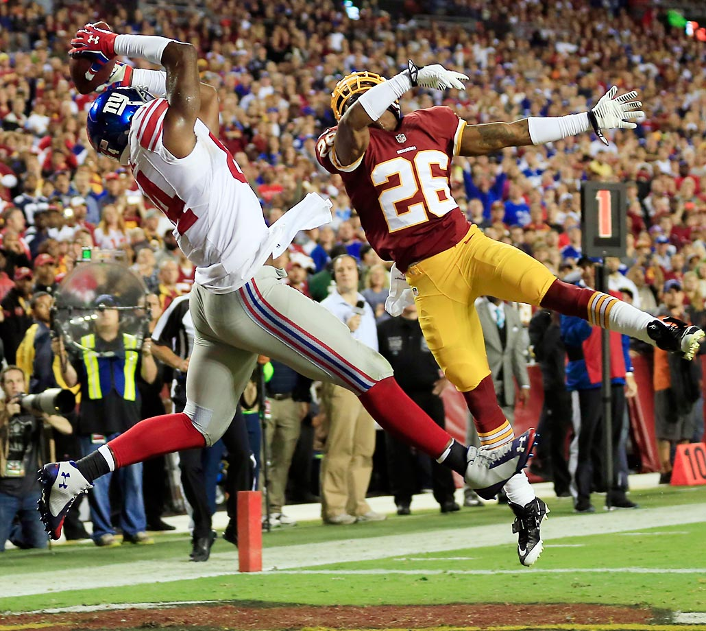 Larry Donnell of the New York Giants catches a pass for a touchdown over Bashaud Breeland of the Washington Redskins.