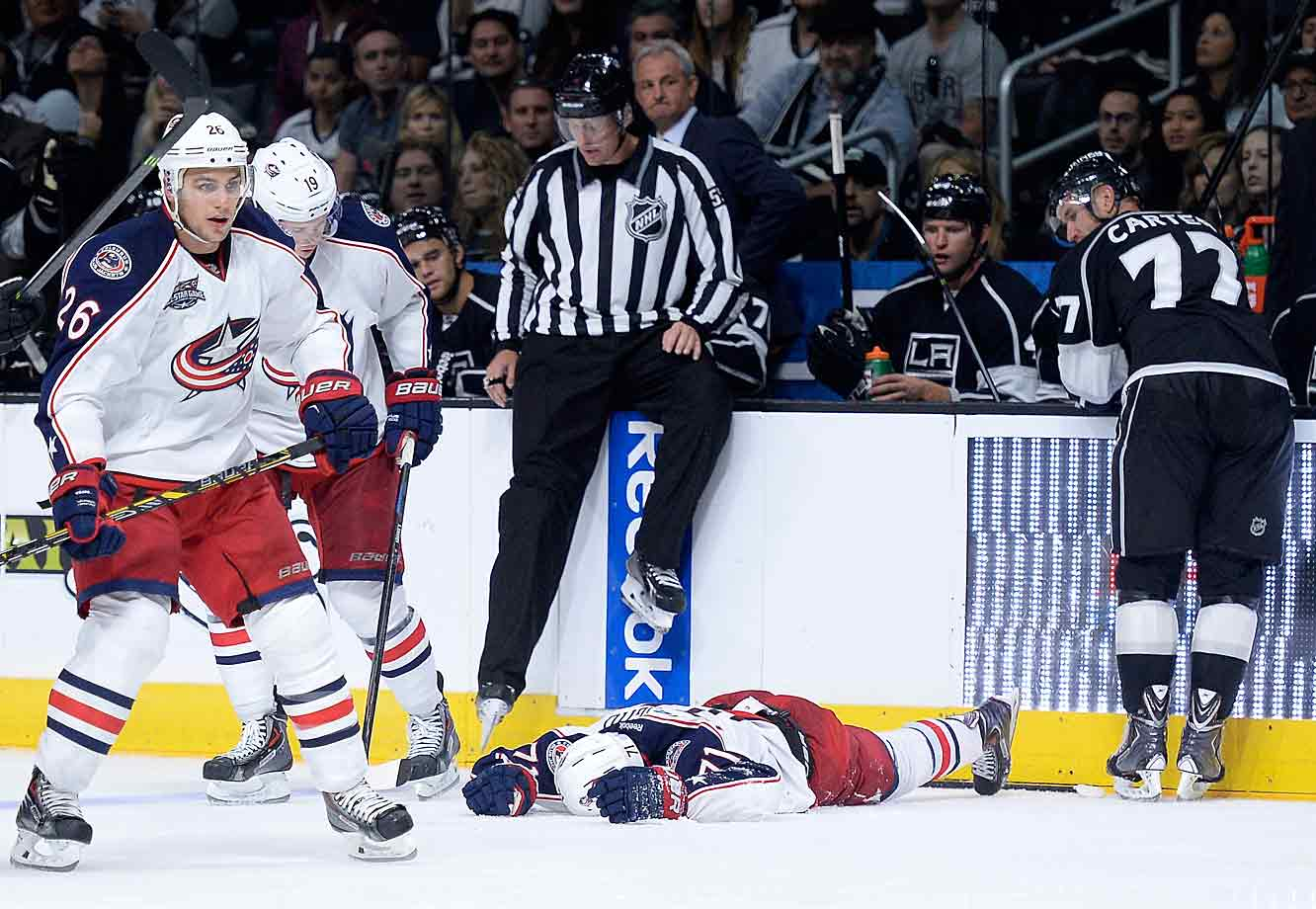 The Blue Jackets forward lies hors de combat on the ice after hitting his head on an official in a collision along the boards during a game against the Kings at Staples Center in L.A. on Oct. 26, 2014. Foligno left the ice on a stretcher, part of a wave of injuries that hit Columbus.