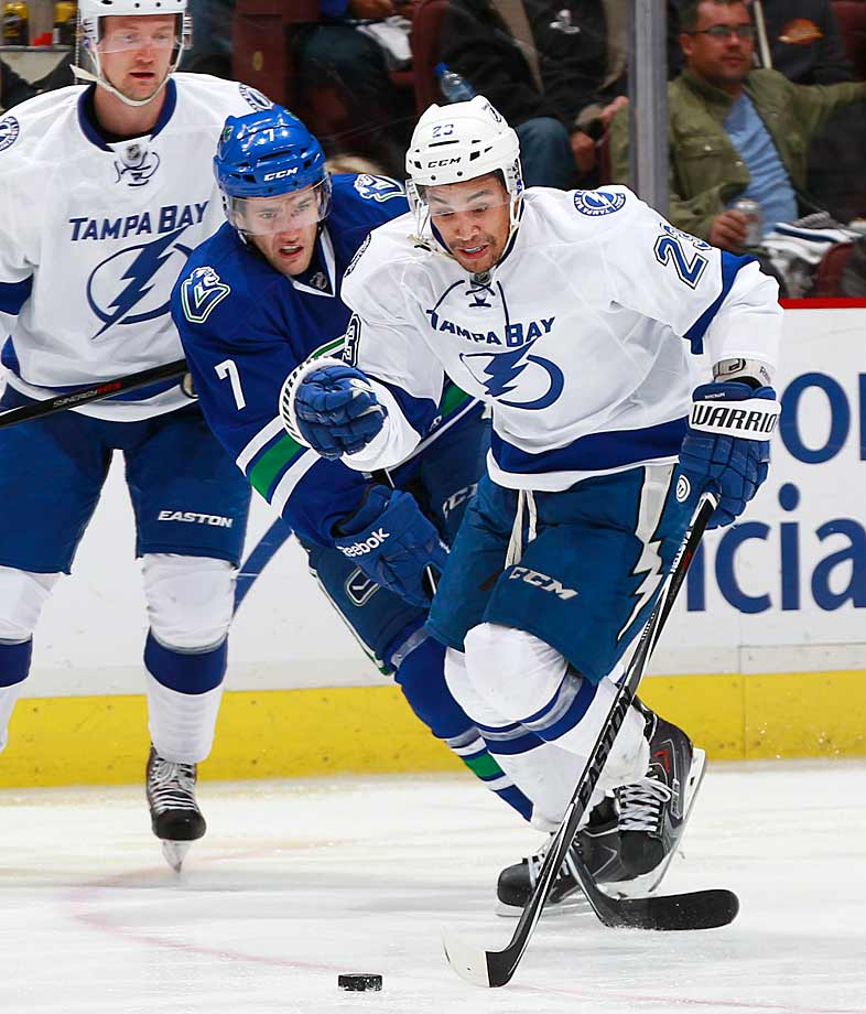 The Canucks and Lightning chase the biscuit at Vancouver's Rogers Arena on Oct. 18.