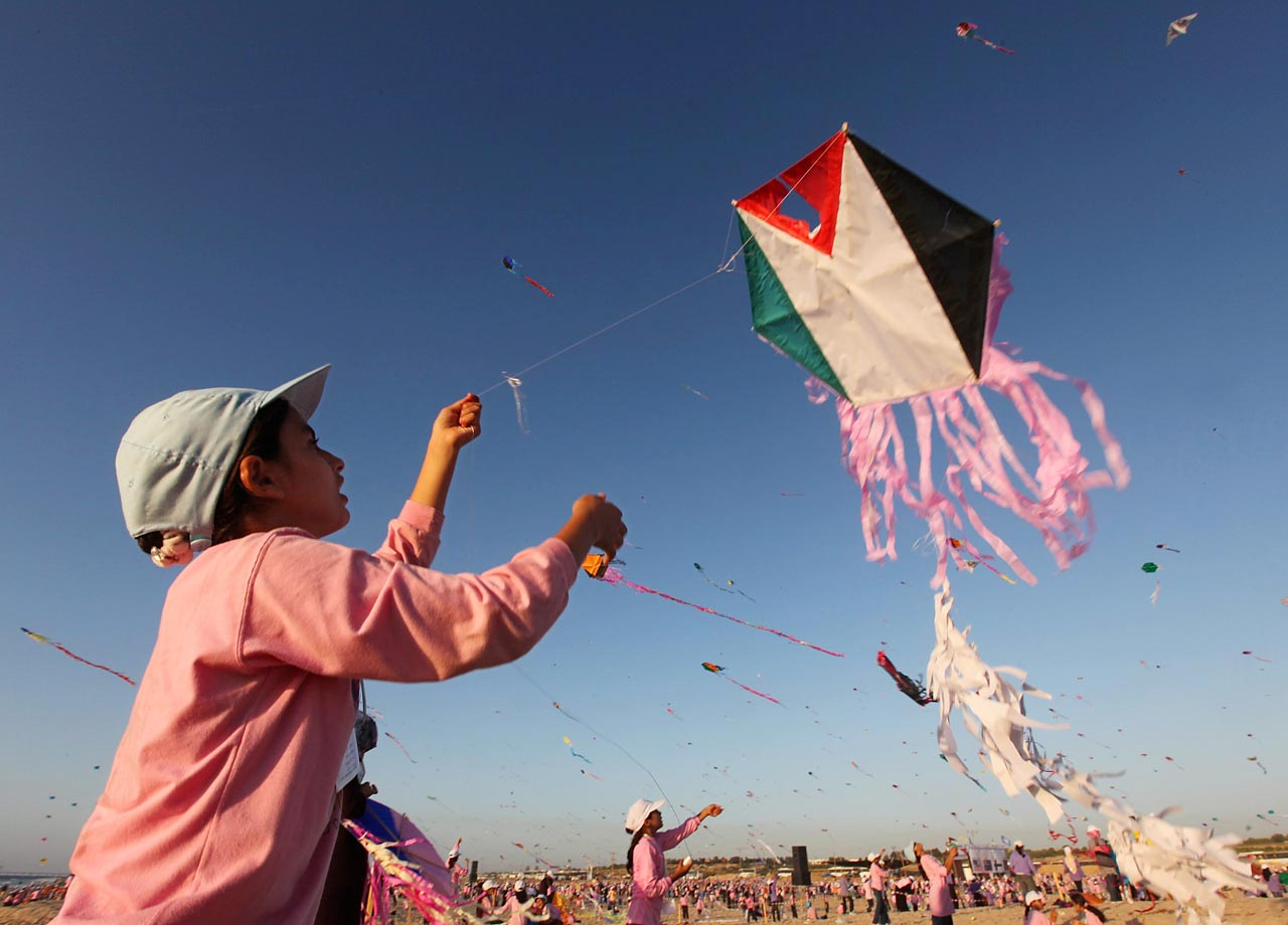 A Palestinian refugee flies a kite during an event held by the United Nations Relief and Works Agency near the Gaza strip. More than 15,000 kites were in the sky.