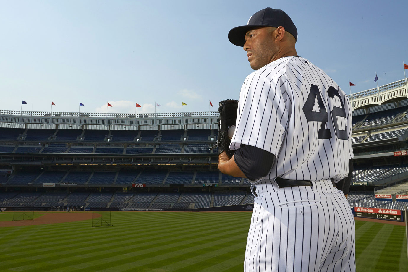 "Rivera, the greatest closer in baseball history, dominated and intimidated hitters with his cut fastball and ""Enter Sandman"" entrance music since breaking in with the Yankees in 1995. In 19 years, all with the Yankees, Rivera racked up an MLB-record 652 saves and appeared in 13 All-Star games. Before his 2012 season was cut short by a torn ACL, he had recorded 30 or more saves in nine straight seasons. Rivera also regularly shined in the postseason, when he saved 42 games, had a 0.70 ERA in 141 innings pitched and helped New York win five World Series titles. Rivera was the last major league player to wear the number 42 full-time, following its league-wide retirement in honor of Jackie Robinson in April 1997."