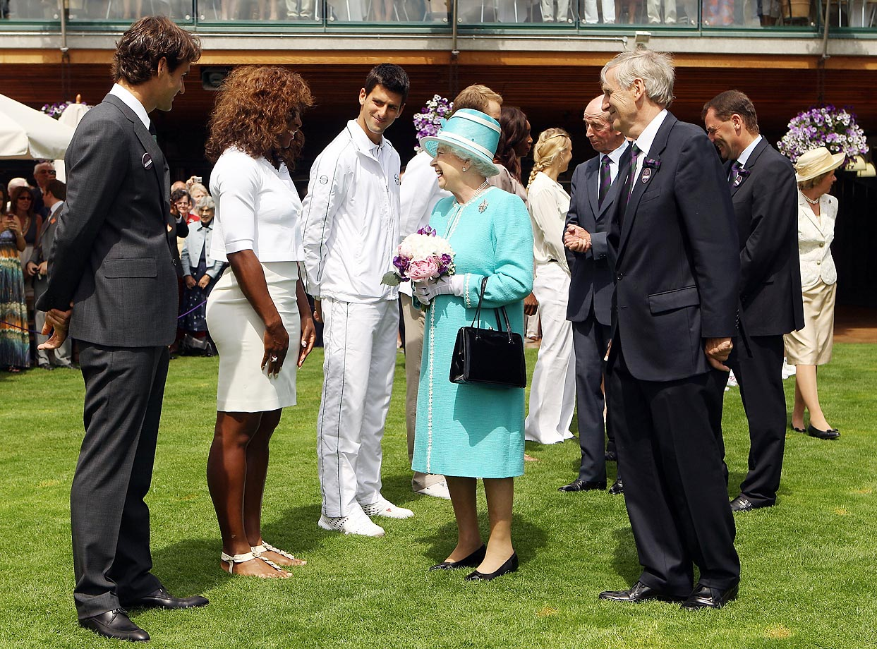 Queen Elizabeth II meets Roger Federer, Serena, Novak Djokovic and others on Day 4 at the All England Lawn Tennis and Croquet Club. It was the first visit by Queen Elizabeth II to the Championships in 33 years.