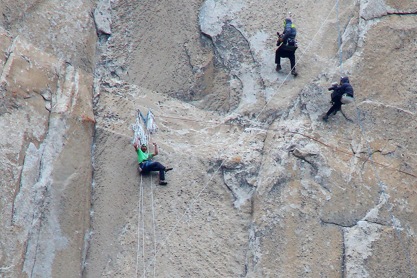 Kevin Jorgeson (in green) celebrating his finish of Pitch 15 while two cameramen shoot video and stills from above.