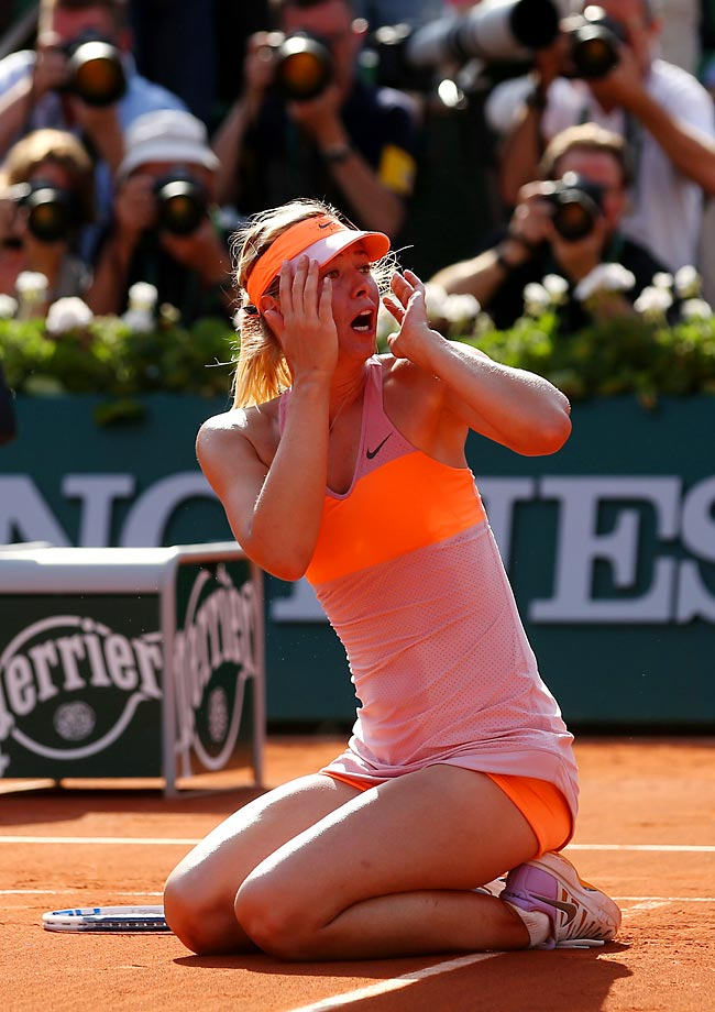 Maria Sharapova celebrates match point during her match against Simona Halep at the French Open.