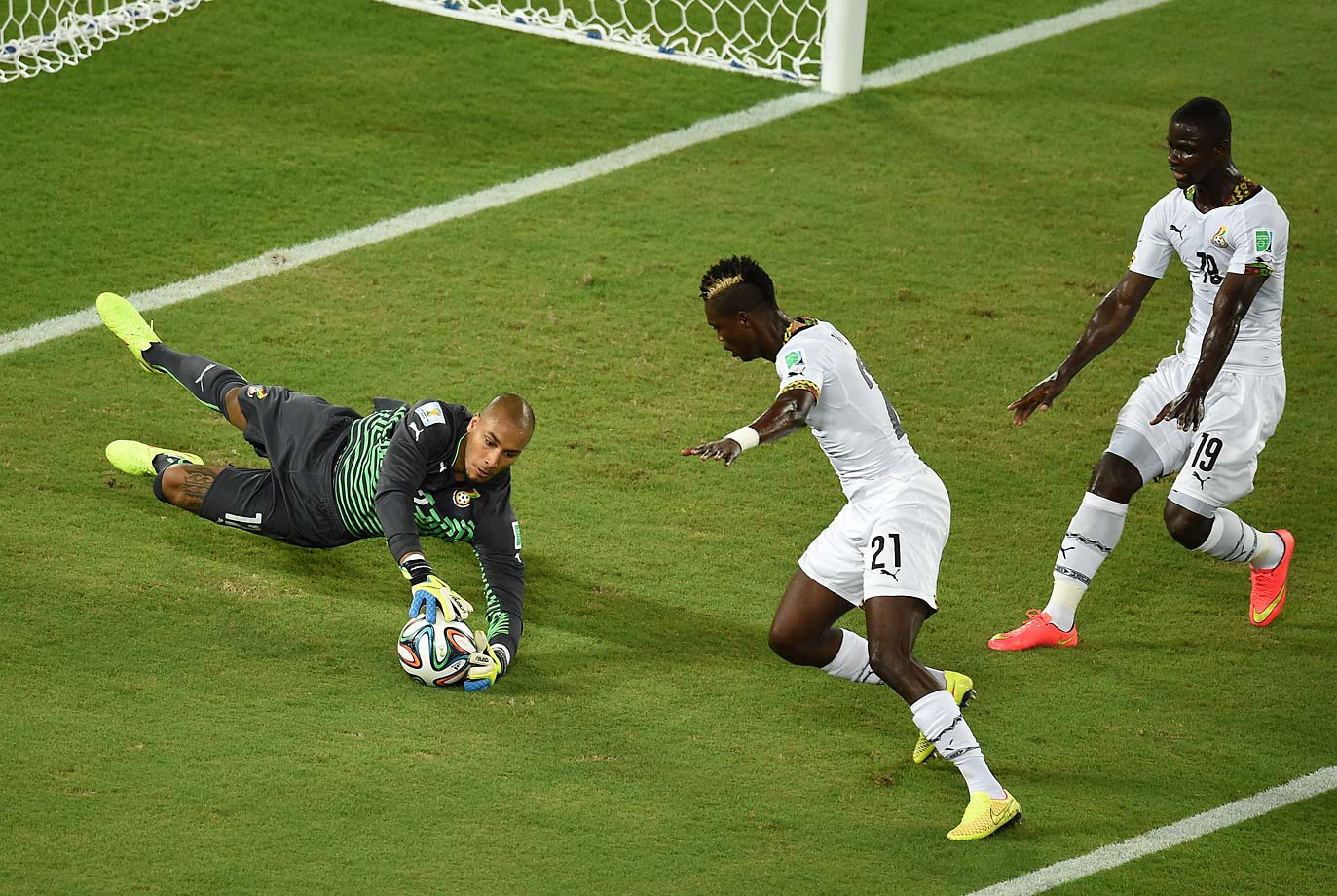 Ghana's goalkeeper Adam Larsen Kwarasey dives for the ball.