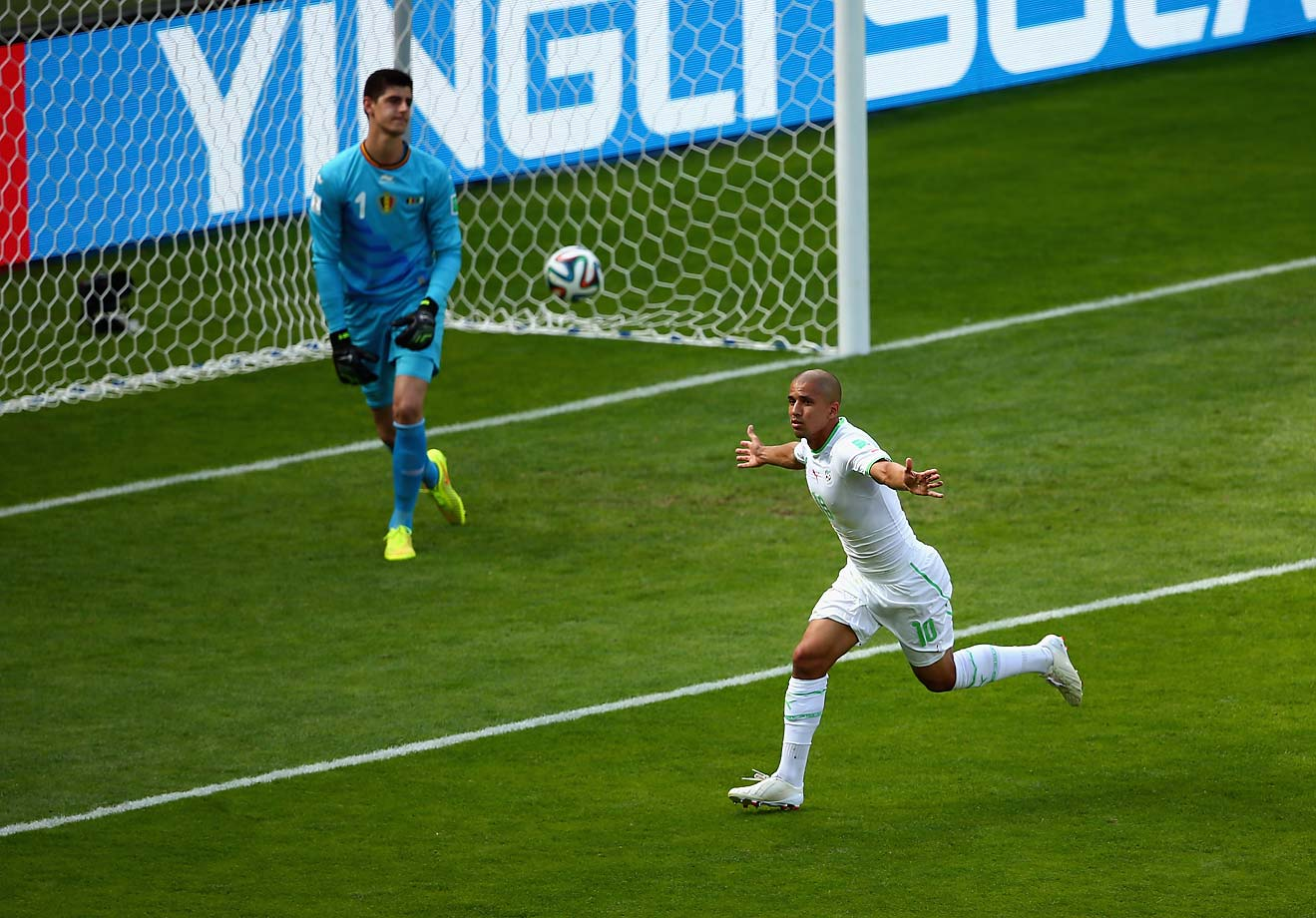 Sofiane Feghouli of Algeria scores the first goal of the Group H match between Algeria and Belgium off of a penalty kick in the first half.