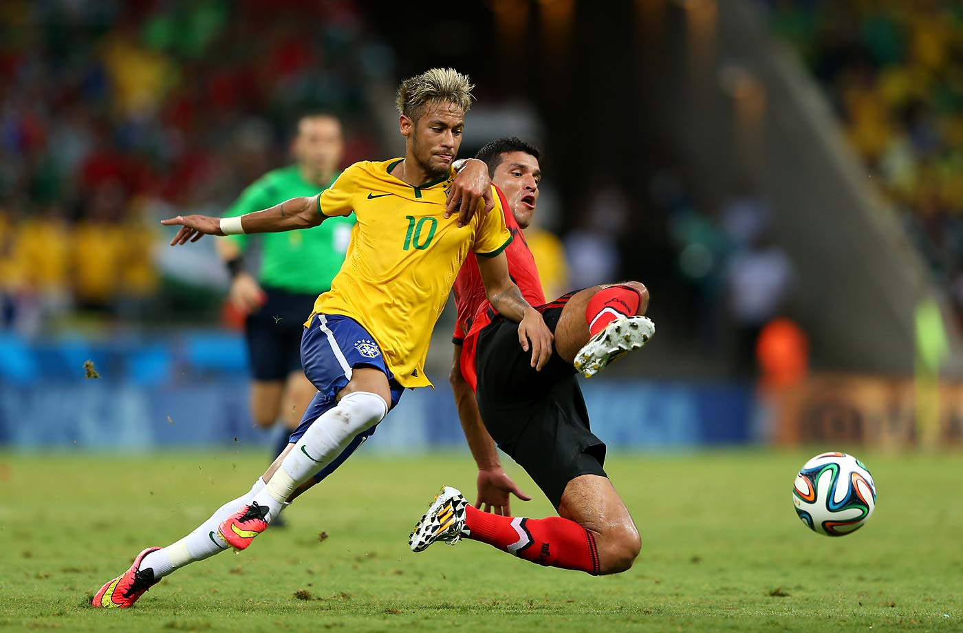 Neymar of Brazil and Francisco Javier Rodriguez of Mexico battle for the ball during the Group A match resulting in a 0-0 draw.