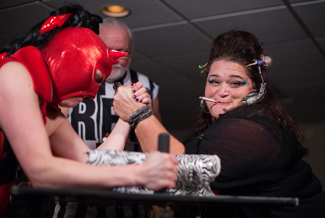 "Amy Smackhouse of the DC Lady Arm Wrestlers (aka D/CLAW) was one smokin' mama as she battled Dona Diabla at the Summer Smackdown in our nation's capital. The charity matches are said to combine ""pro wrestling antics with bouts of sassy strength."""