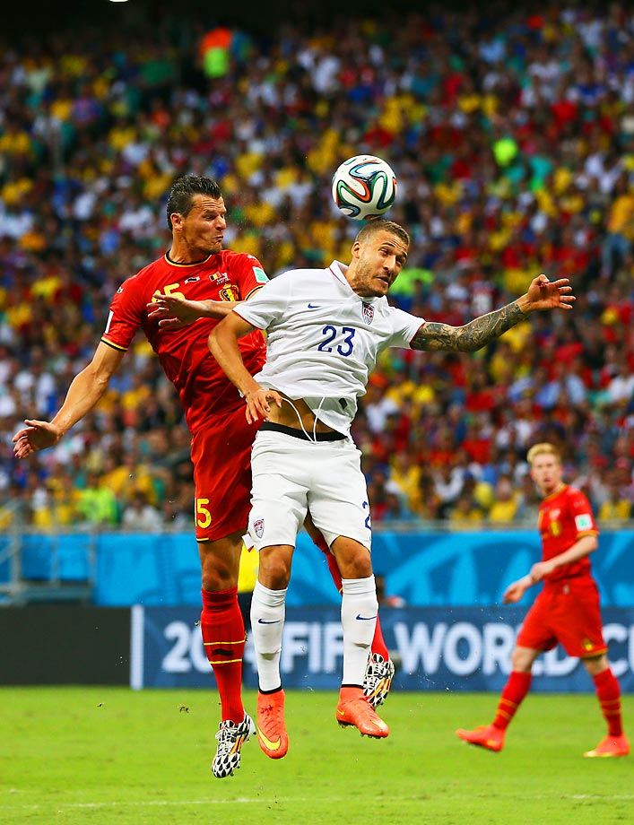 United States' Fabian Johnson and Belgium's Daniel Van Buyten go up for a header.