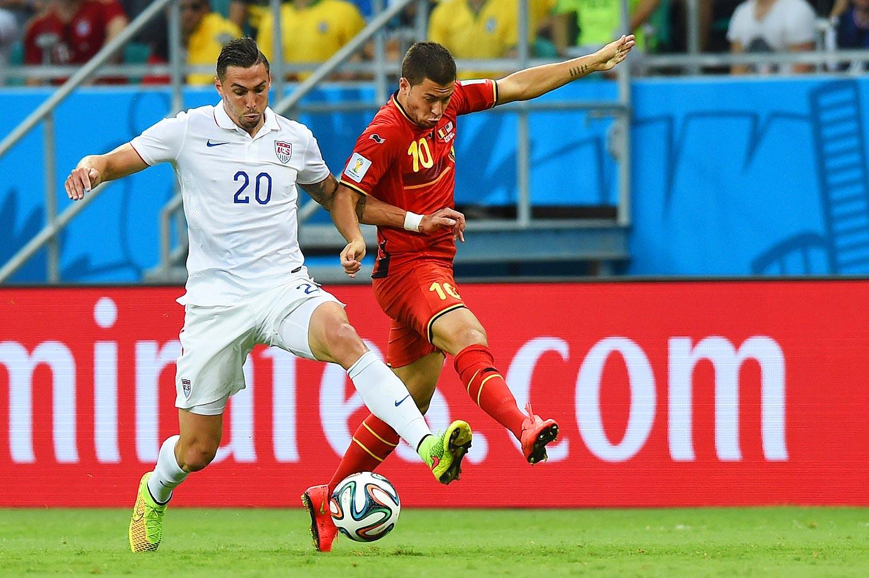 American defender Geoff Cameron tries to hold off Belgium's Eden Hazard.