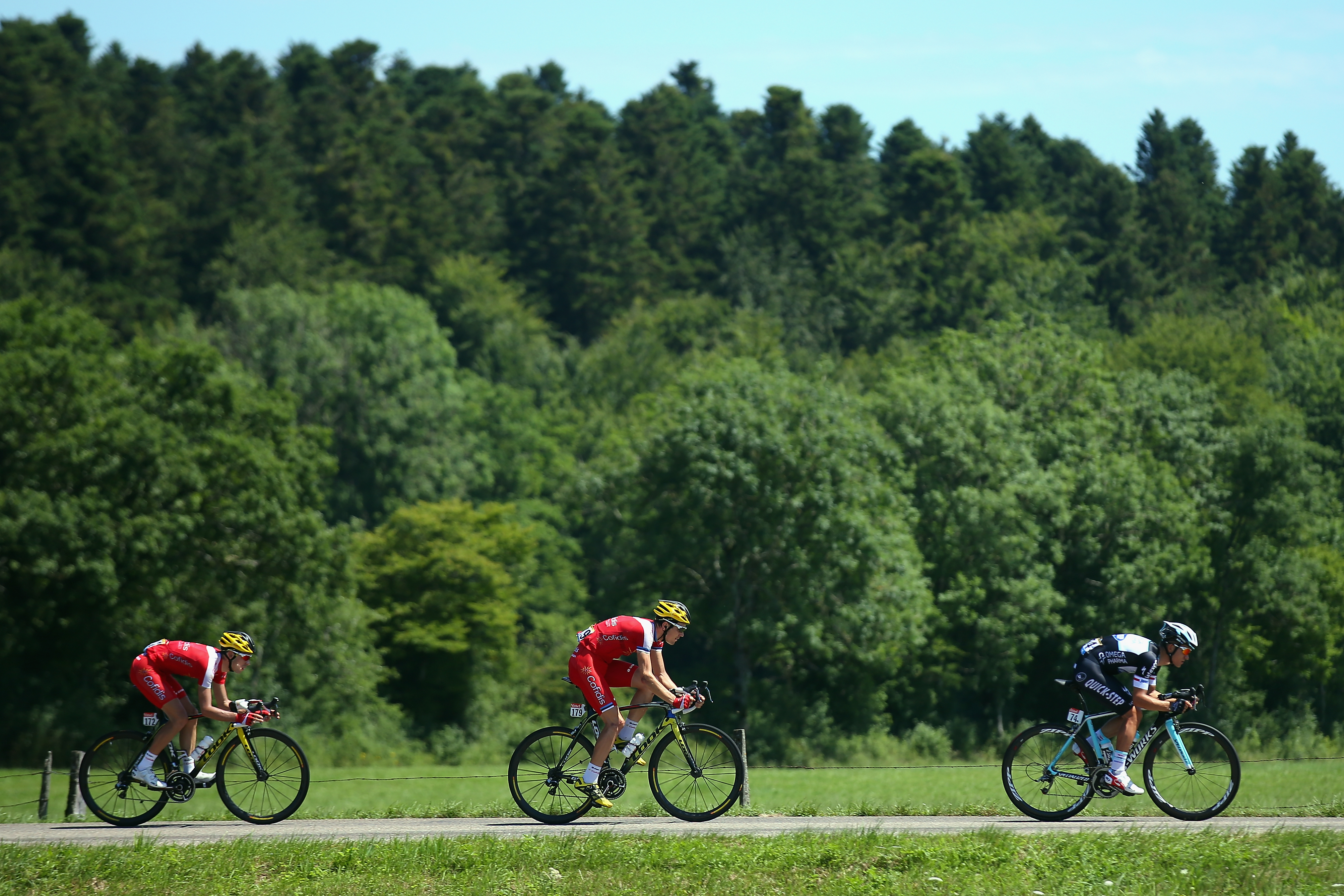 Nicolas Edet of Cofidis, Rein Taaramae of Cofidis and Michal Kwiatkowski of Omega Pharma-Quickstep in action during the eleventh stage.