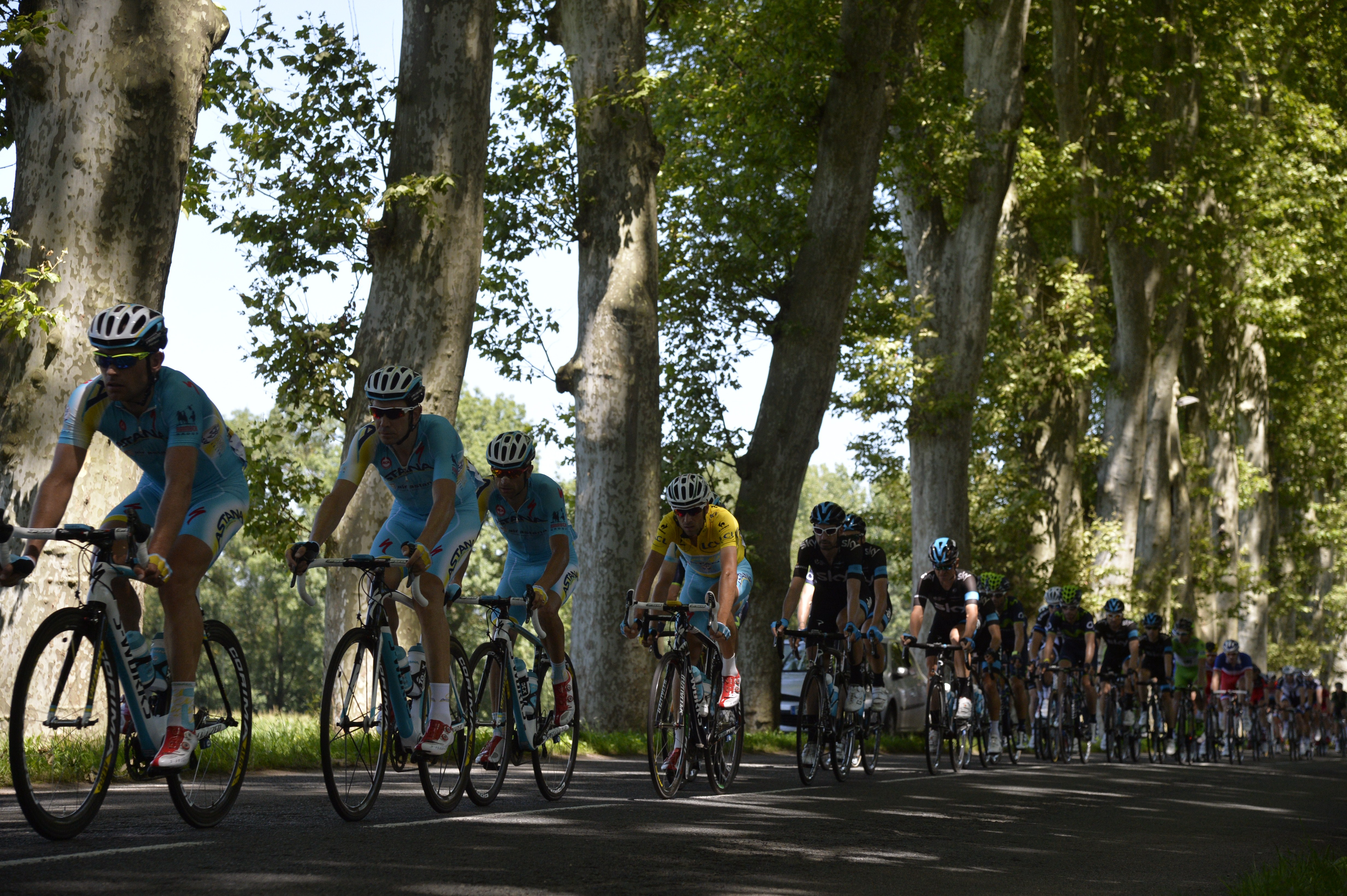 Italy's Vincenzo Nibali wearing the overall leader's yellow jersey, rides in the pack behind his Kazakhstan's Astana teammates during the 185.5 km twelfth stage.