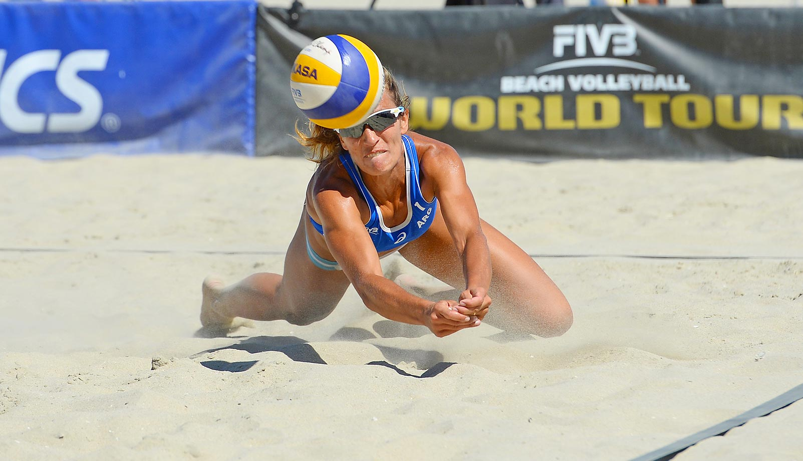 Ana Gallay dives for a difficult dig at the FIVB Long Beach Grand Slam in California.