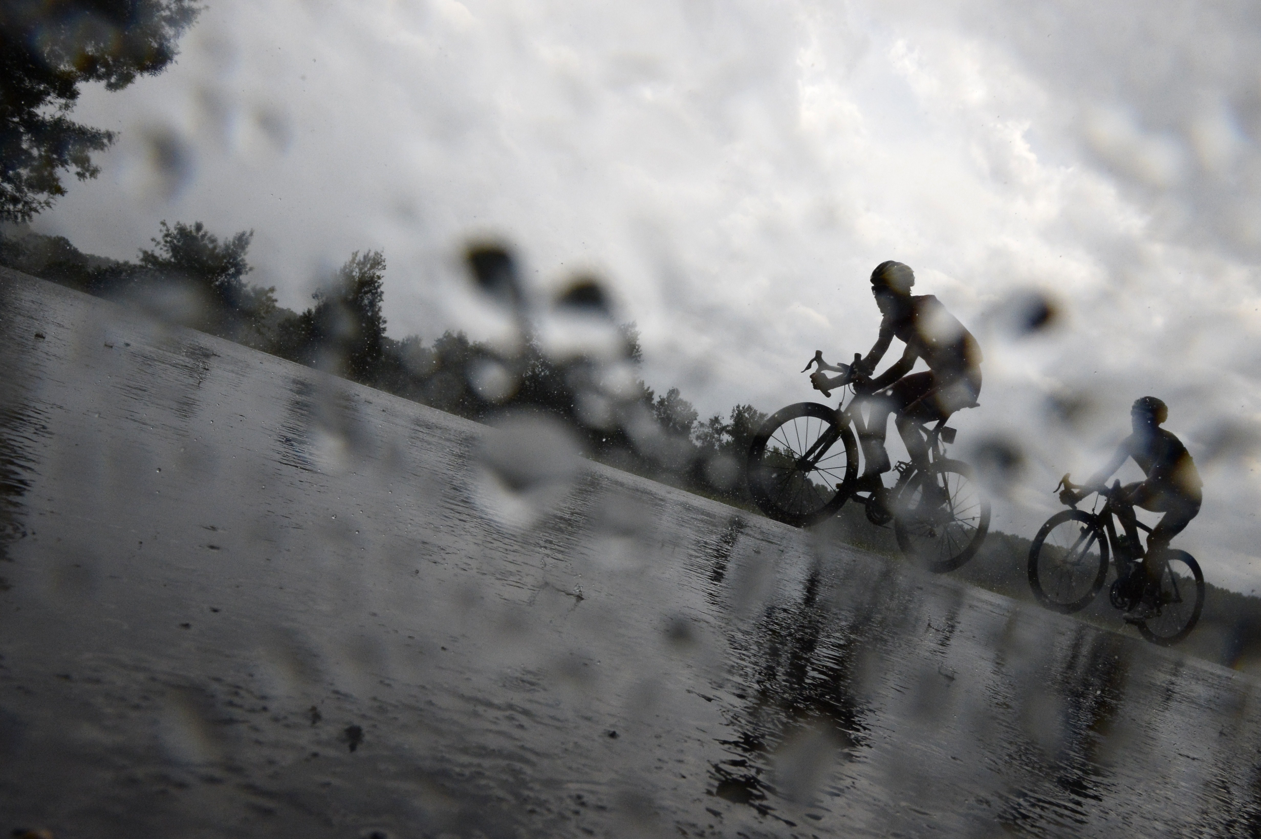 Cyclists ride under a heavy rain during the 208.5 km nineteenth stage.