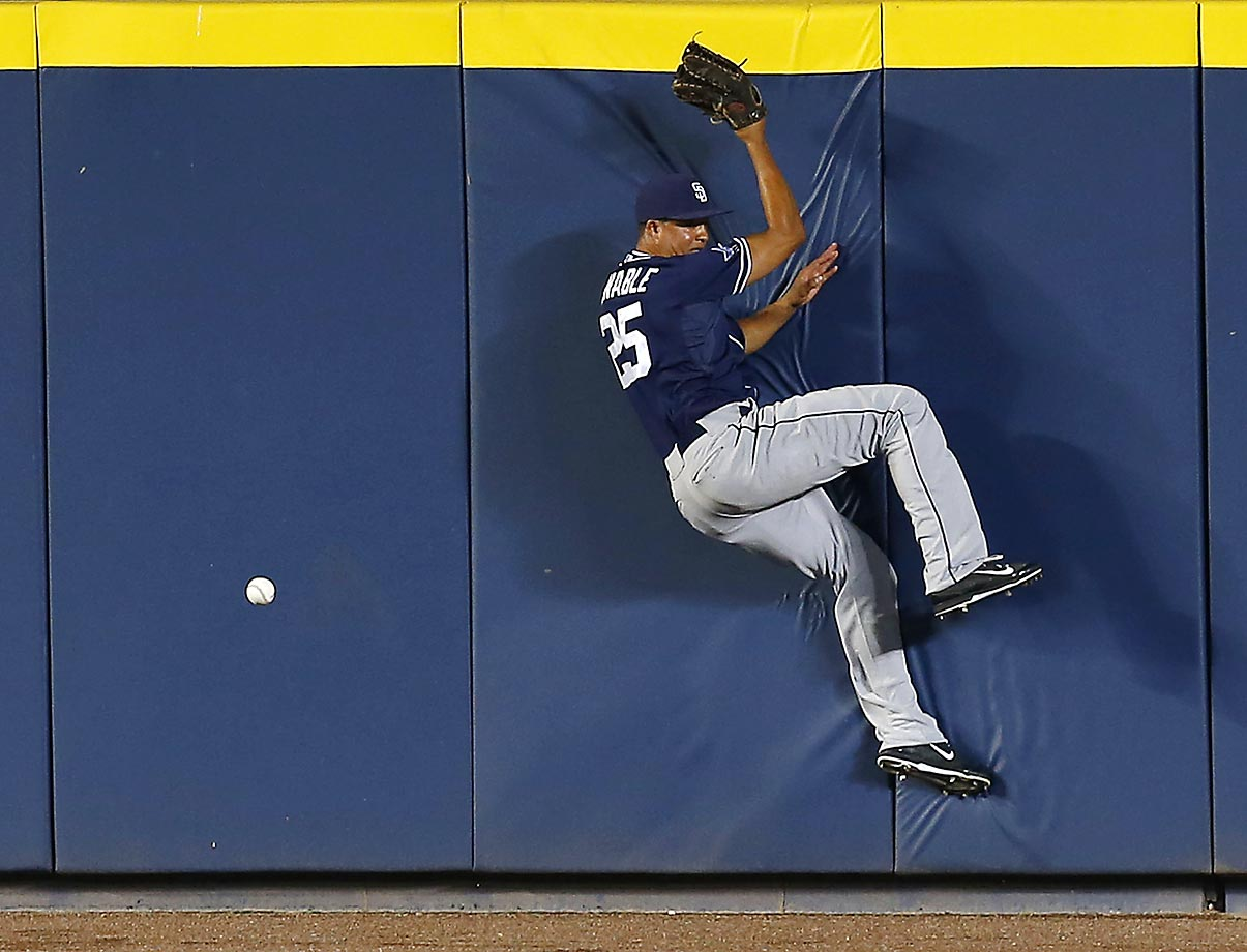 San Diego Padres center fielder Will Venable goes crashing into the wall trying to catch a bomb hit by Freddie Freeman of the Braves.