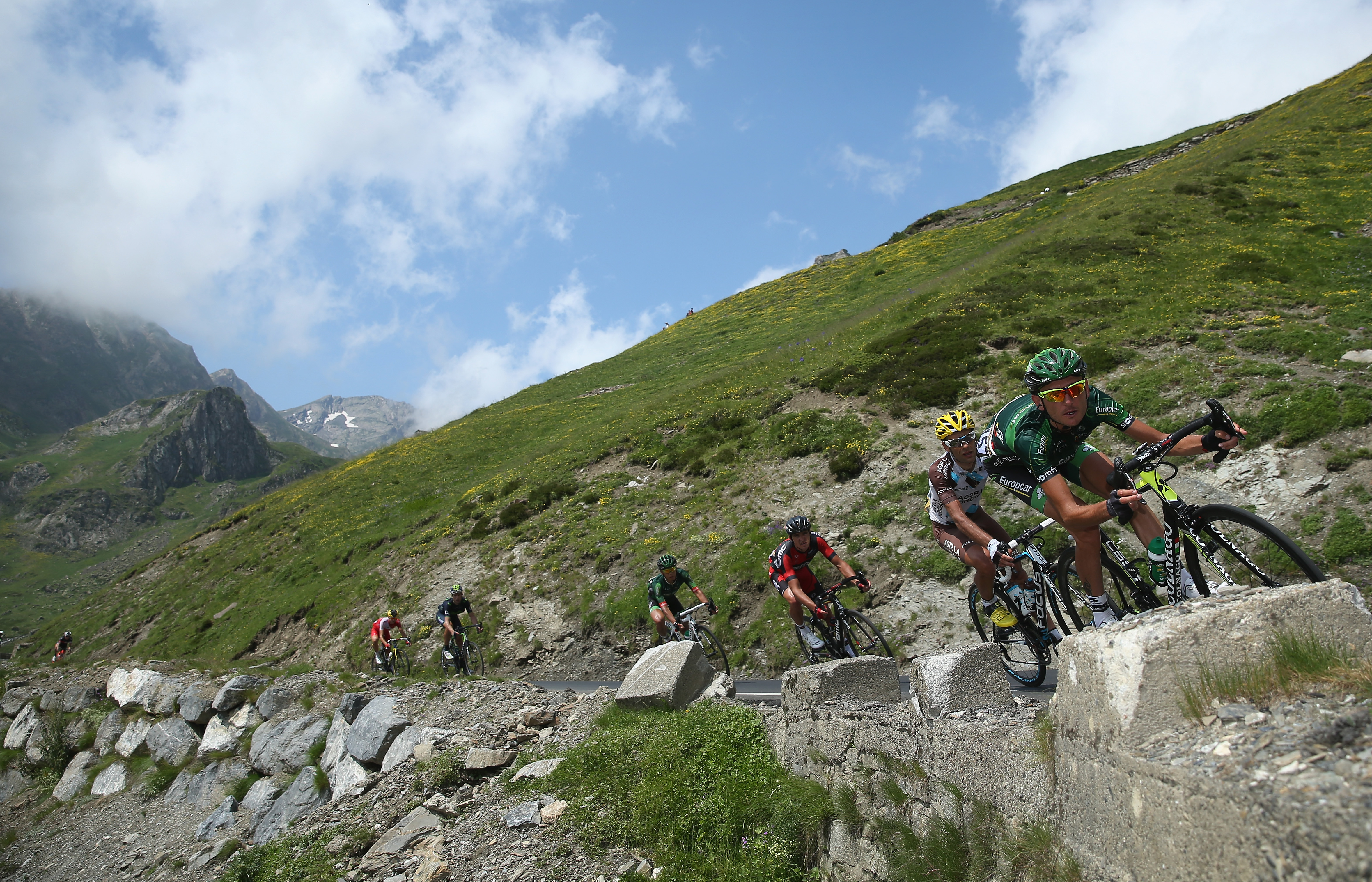 Perrig Quemeneur of France and Team Europcar leads riders on the descent of the Col du Tourmalet during the eighteenth stage.
