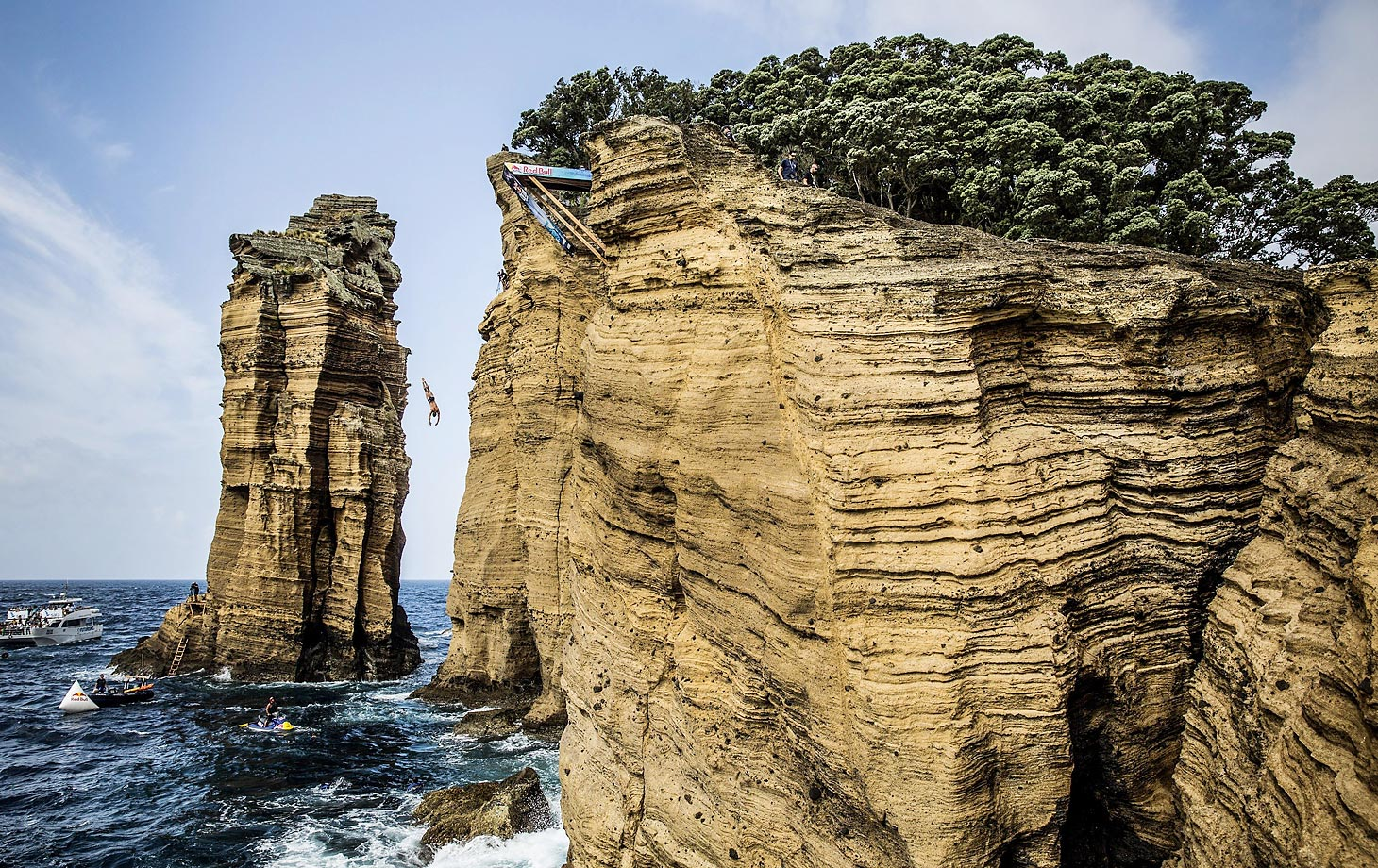Daring USA cliff diver David Colturi plunges from the 27 metre platform on Islet Vila Franca do Campo during the Red Bull Cliff Diving World Series in Portugal.