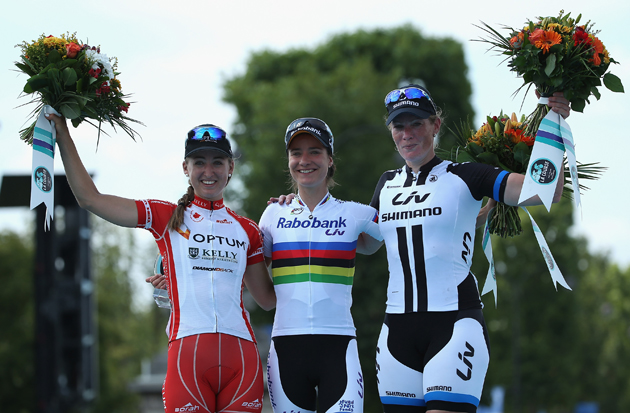 Marianne Vos of the Netherlands and Rabo Liv celebrates victory on the podium with second placed Kirsten Wild of the Netherlands and Team Giant-Shimano (right) and third placed Leah Kirchmann of Canada and Optum-Kelly Benefit Strategies (left), following La Course by Le Tour de France.