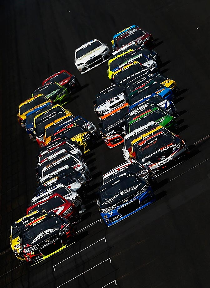 Jeff Gordon and Kasey Kahne lead the pack to a restart during the Brickyard 400 in Indianapolis. Gordon went on to win the race for a NASCAR-record fifth time.