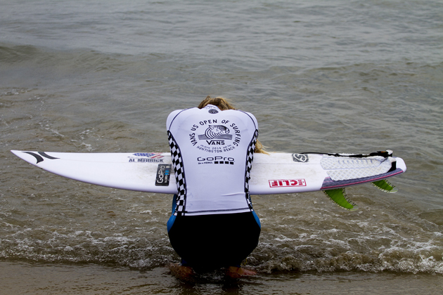 Lakey Peterson takes a moment to herself prior to surfing her quarterfinal heat at the Vans U.S. Open of Surfing.