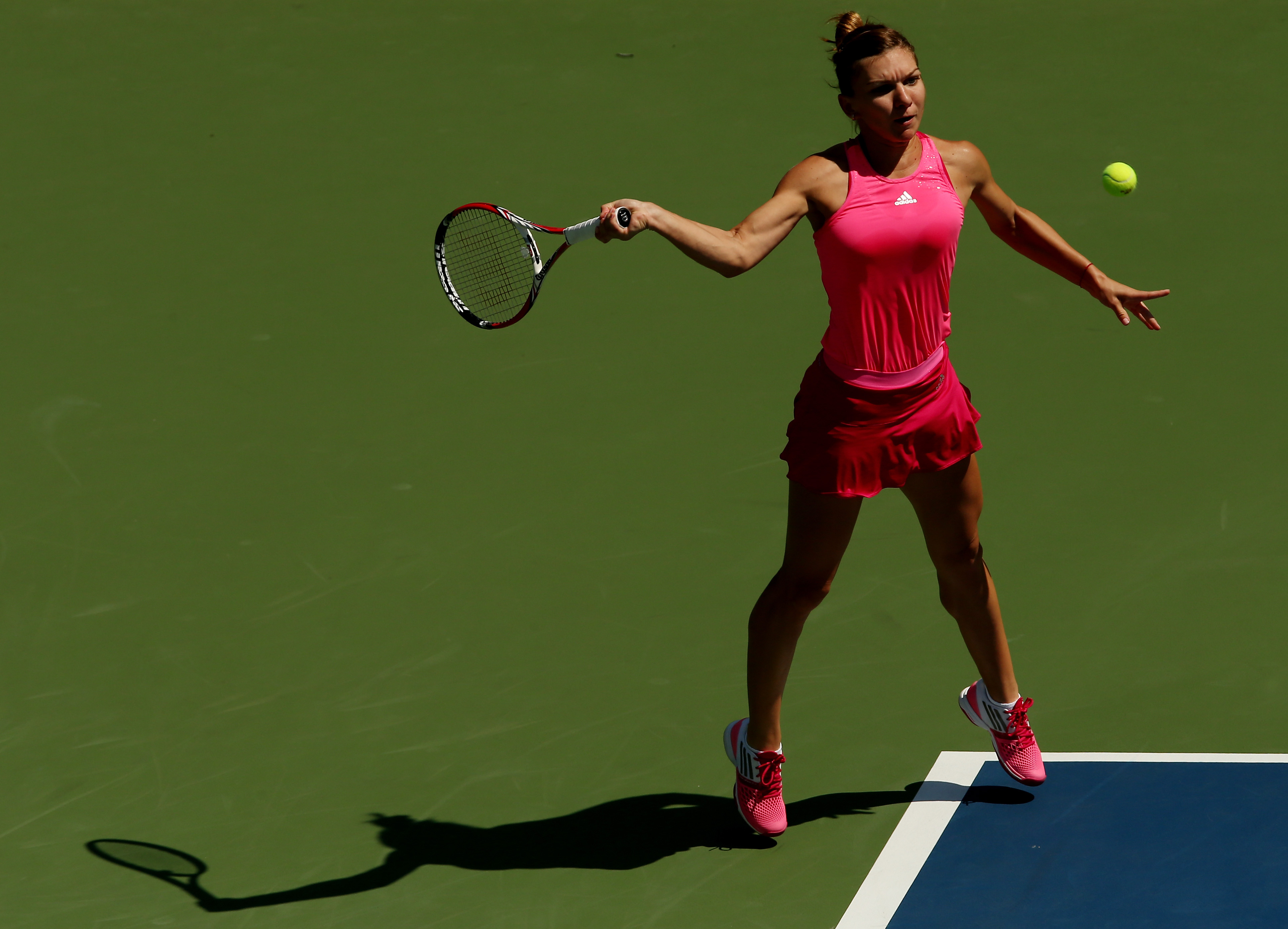 Leave it to Halep to make an all-pink outfit look jockish.