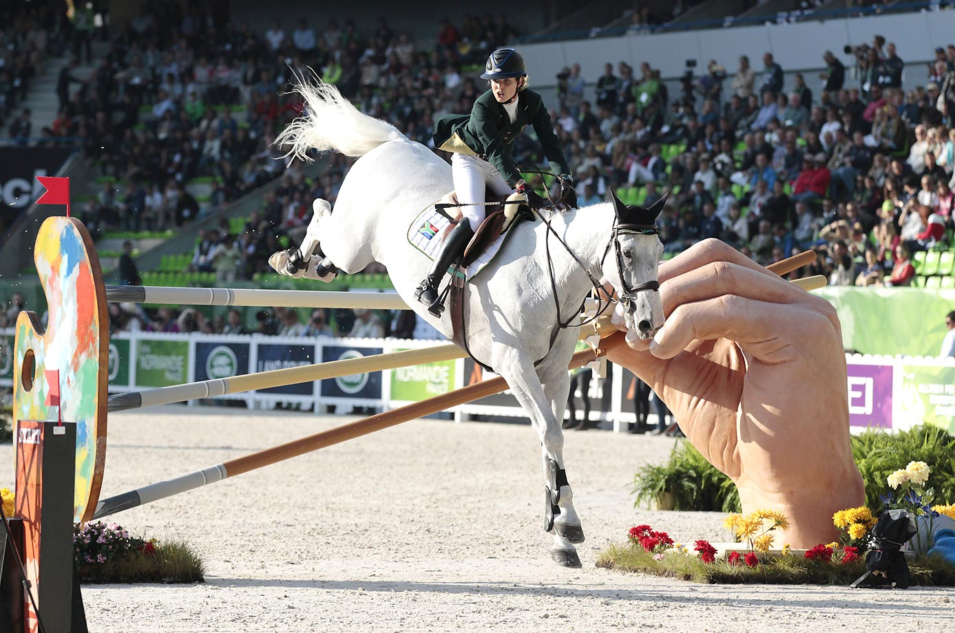 Cara Bianca Frew of South Africa rides Leopold Pierreville during the Individual Jumping competition of the 2014 FEI World Equestrian Games.