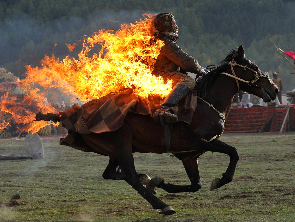 A Kyrgyz stuntman performs during the first World Nomad Games in the Kyrchin.