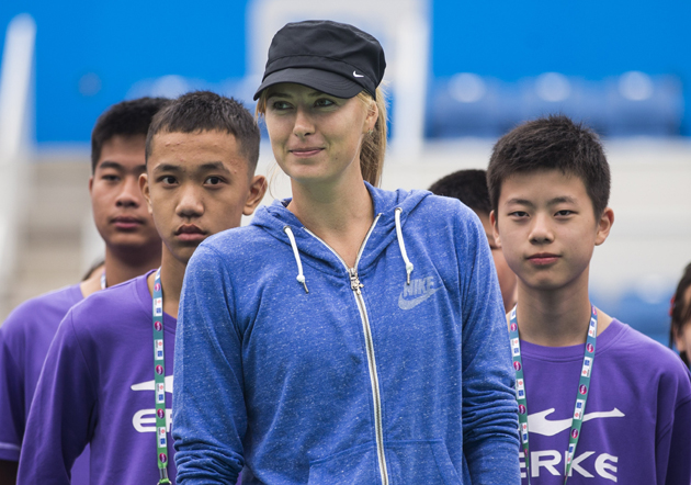 Maria Sharapova signs autographs for ball boys ahead of the start of 2014 WTA Wuhan Open at Optical Valley International Tennis Center.