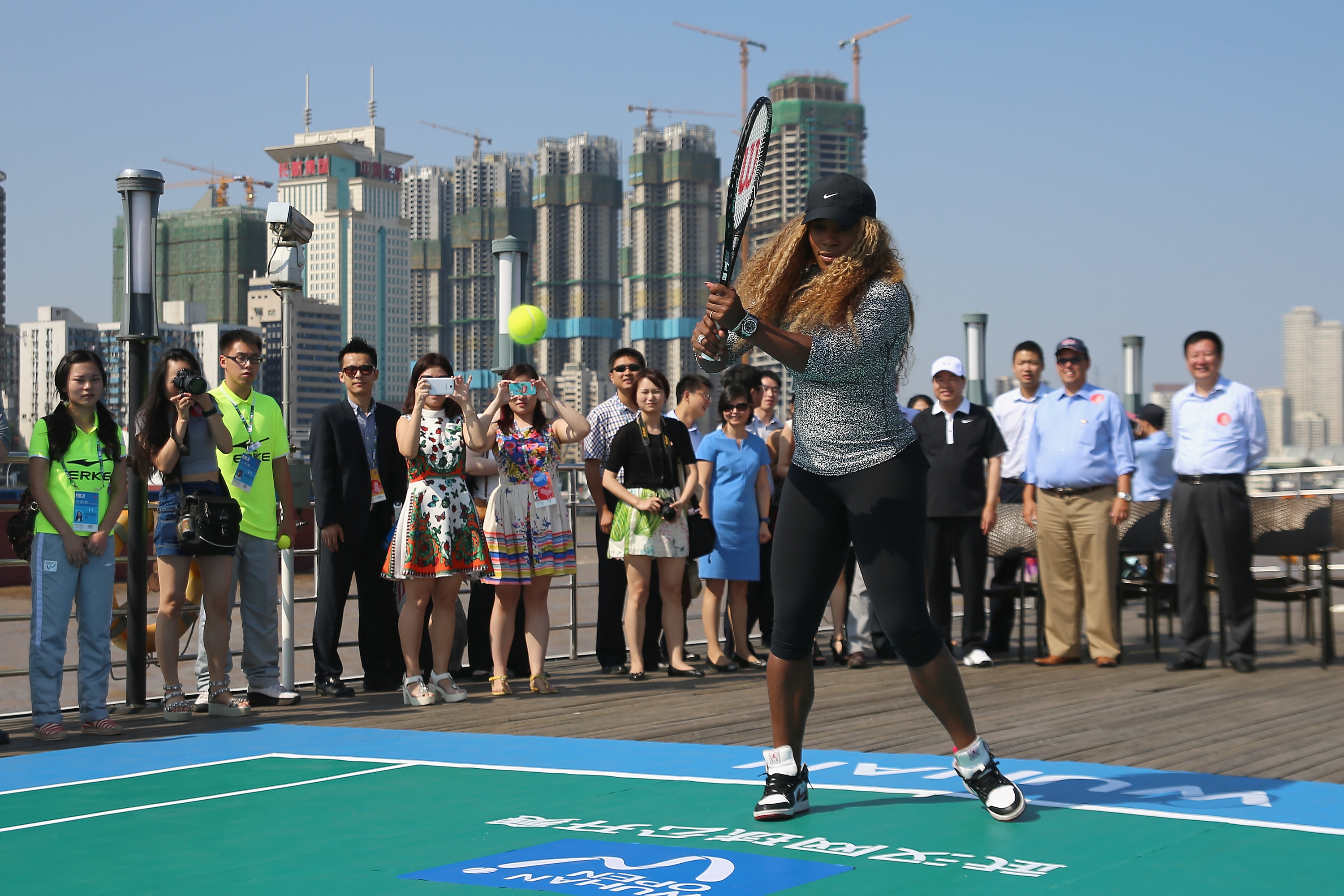 Serena Williams plays a shot on deck of a ship during the Changjiang River cruise event at the Wuhan Open.
