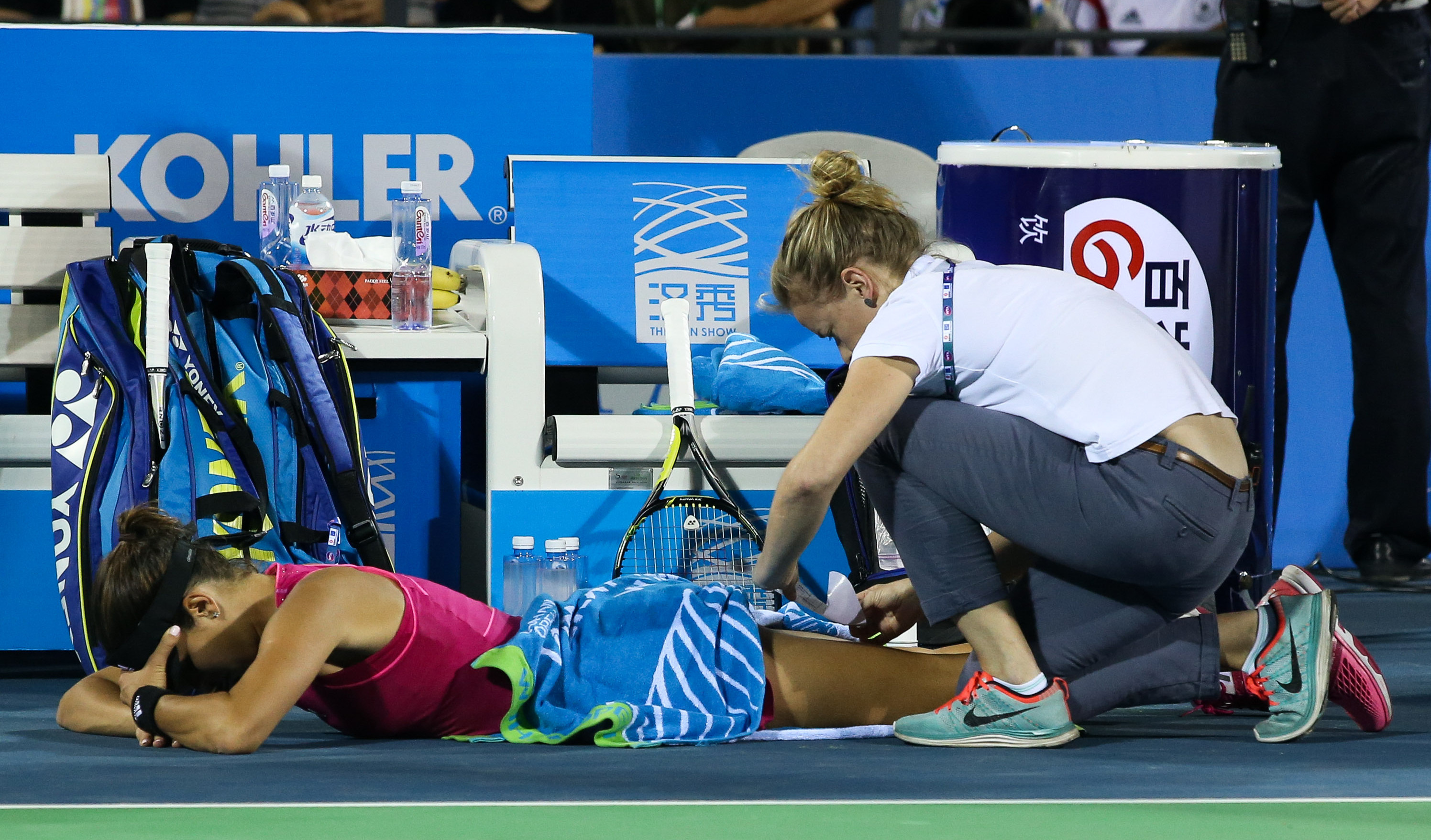 Ivanovic gets treatment on her leg from a trainer.
