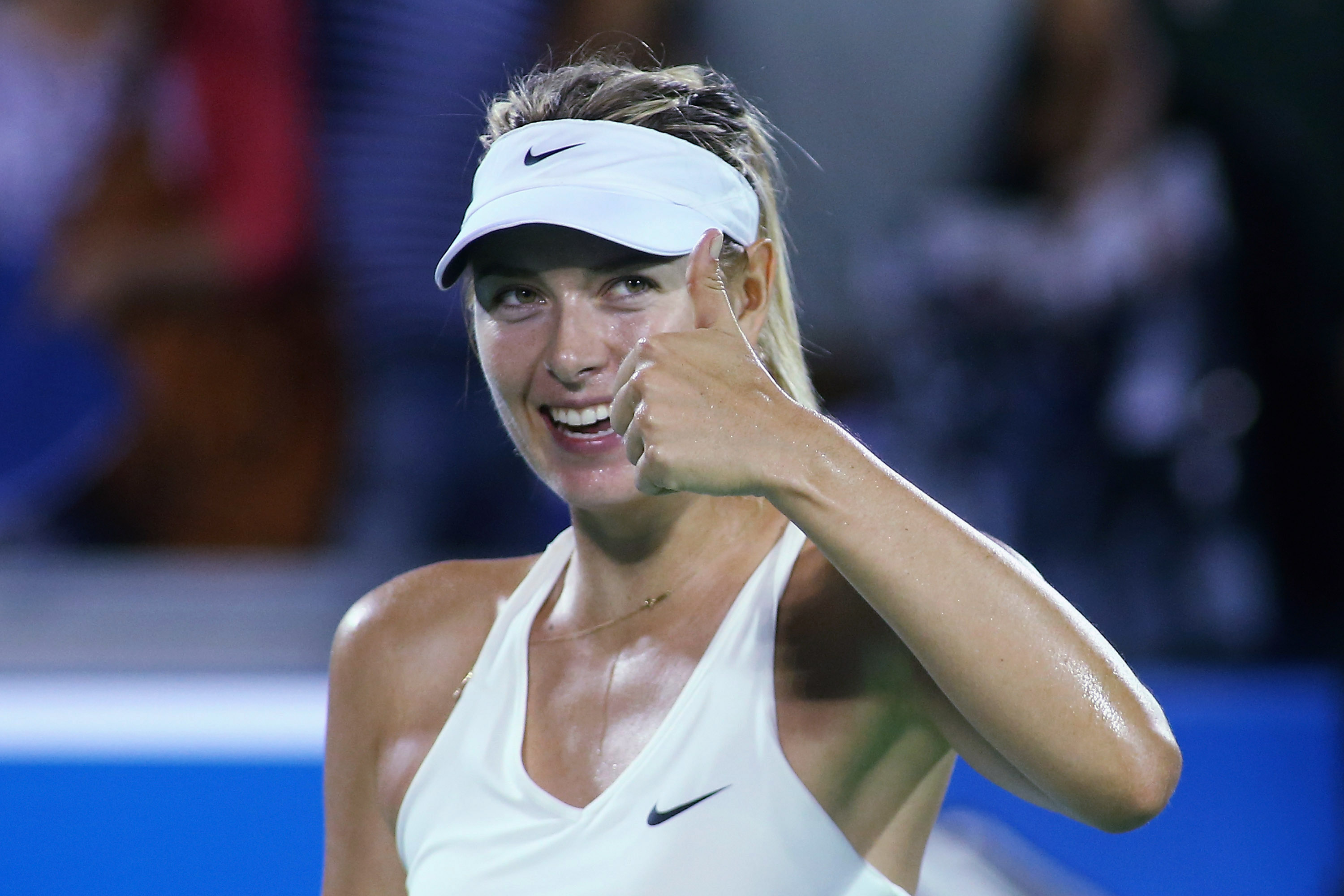 Maria Sharapova gives a thumbs up to the crowd after her win against Kuznetsova.