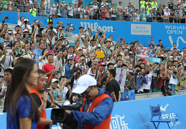 Fans of Li Na attend her retirement ceremony in Wuhan, China.