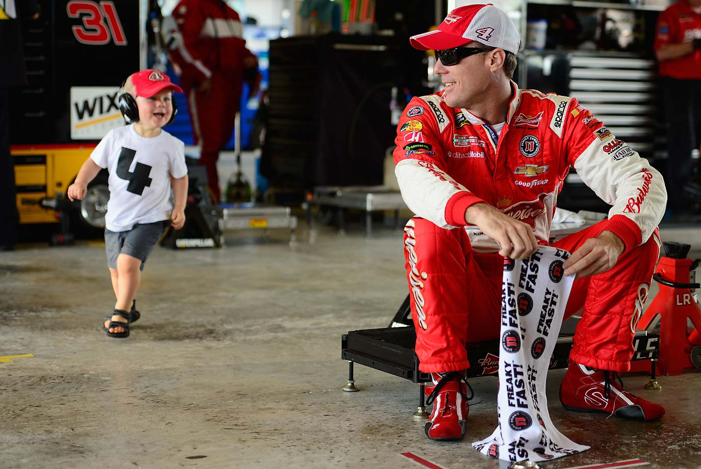 Kevin Harvick and his son, Keelan, spend time in the garage during practice for the final race of the 2014 Sprint Cup Series.