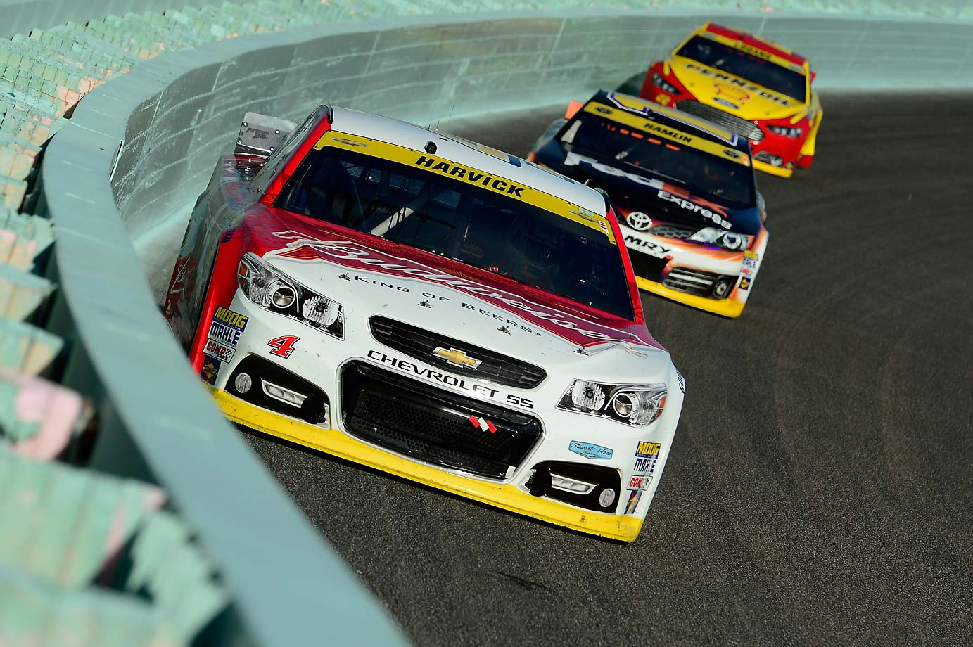 Kevin Harvick leads Denny Hamlin and Joey Logano during the final race of the 2014 NASCAR season.
