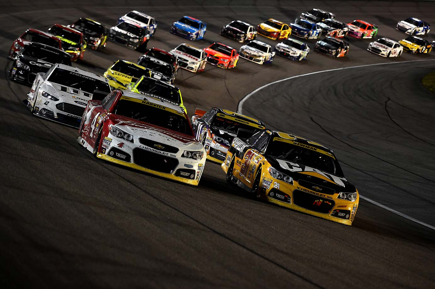 Kevin Harvick leads a pack of cars during the 2014 season finale.
