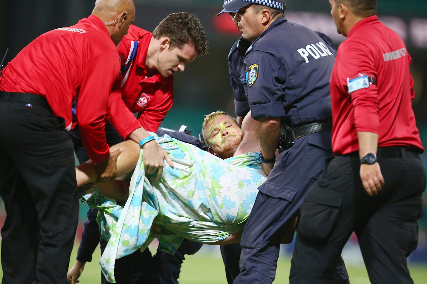 A streaker gets wrapped up and shuffled out during Game 5 of the One Day International series between Australia and South Africa.
