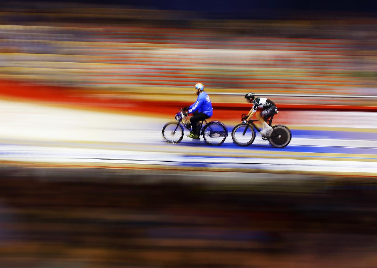 You would think the three-speed would be slower…     Iljo Keisse of Belgium (right) riding in the Ghent 6 day velodrome race in Belgium.