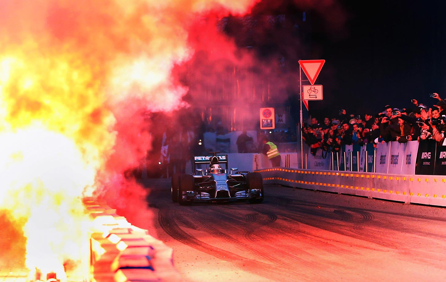 Fireworks explode as Lewis Hamilton drives during the annual Mercedes Benz Stars & Cars event in Stuttgart, Germany.