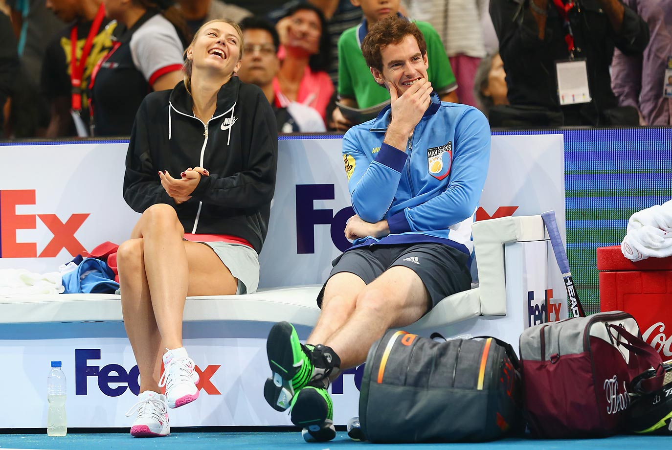 Maria Sharapova and Andy Murray share a joke at the Coca-Cola International Premier Tennis League at the Mall of Asia Arena.