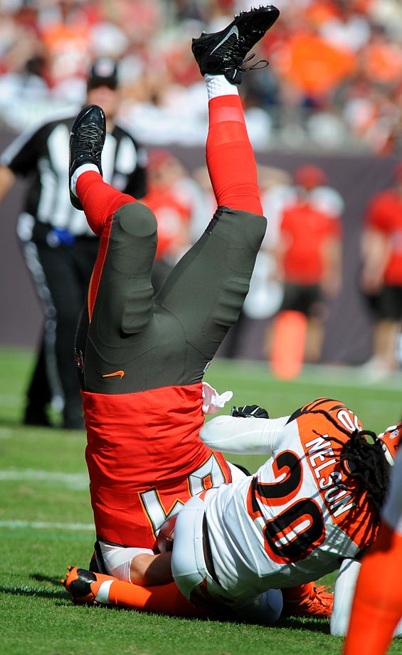 Cameron Brate of Tampa Bay flips after making a catch against Reggie Nelson of the Bengals.