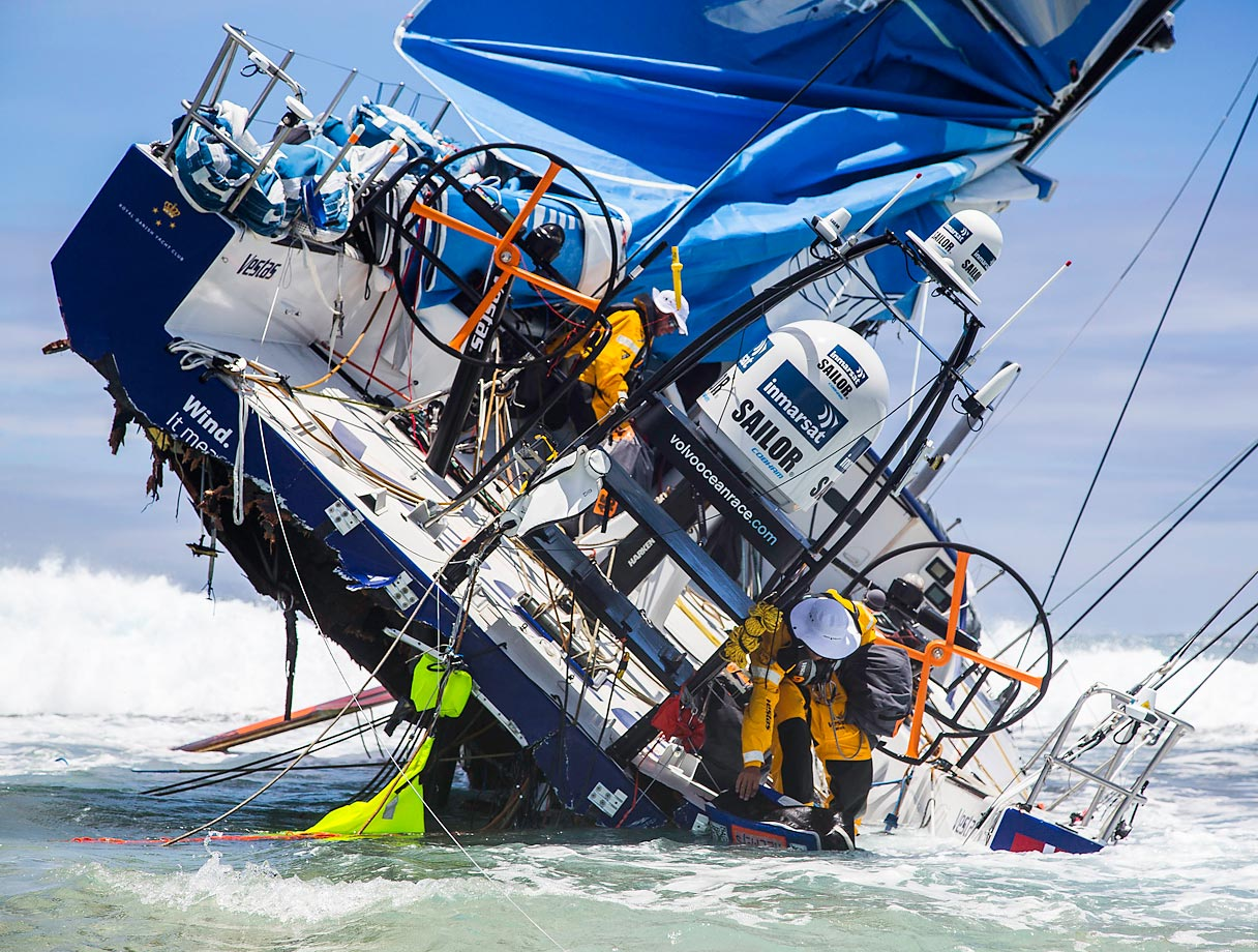 The crew of Team Vestas Wind heads back to the boat to retrieve everything it can; including ropes, diesel, Inmarsat dome and sails, following the grounding of the boat on a reef.