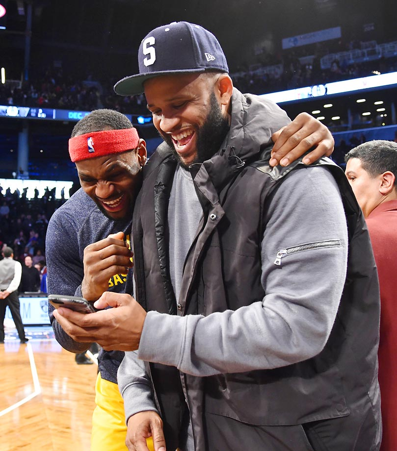 LeBron James and C.C. Sabathia share a laugh after the Cavaliers game against the Brooklyn Nets at the Barclays Center.
