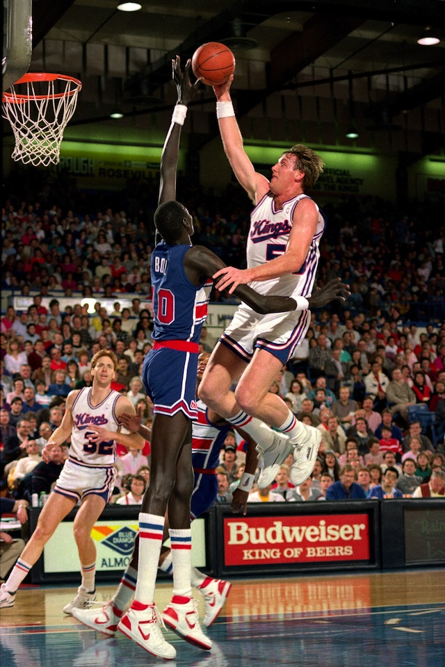Manote Bol #10 of the Washington Bullets blocks a shot attempt by Mark Olberding #53 of the Sacramento Kings during a game played on February 14, 1987 at Arco Arena in Sacramento, California.