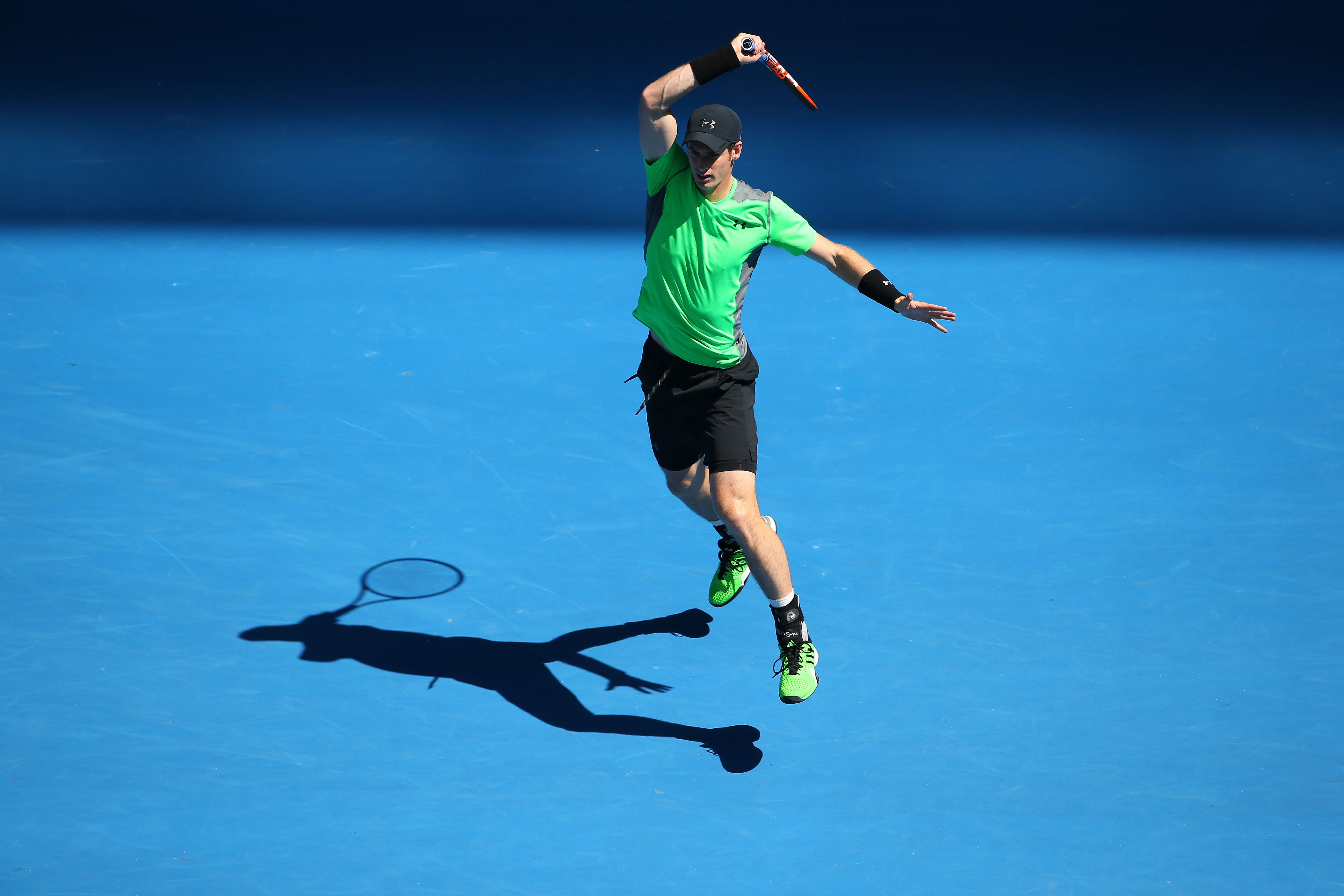 Murray wears the black and bright green combo well, and it's a bit more subdued than some of the other neon colors.