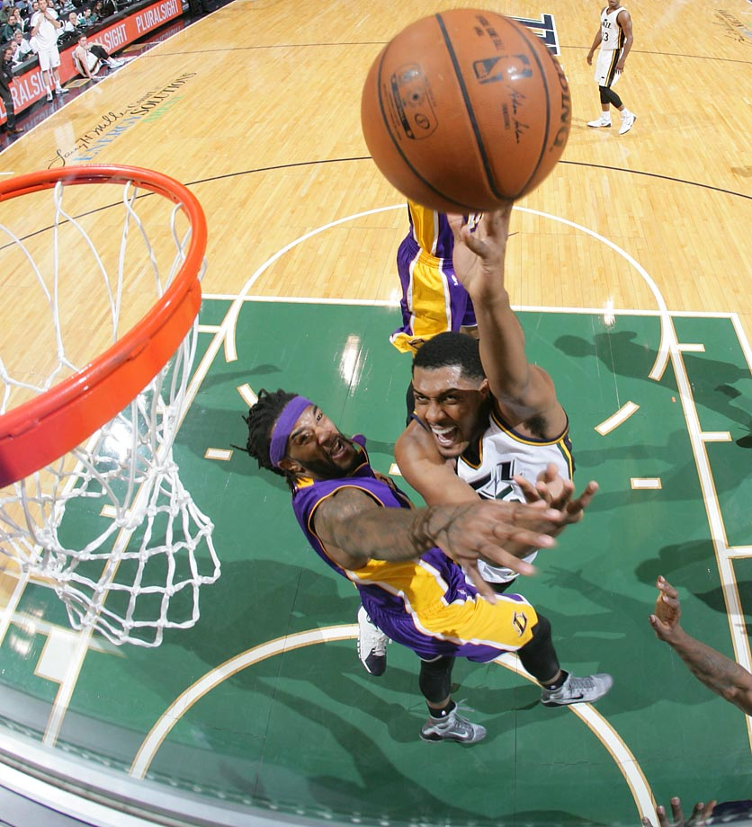 Derrick Favors (15) of the Utah Jazz goes up for a basket during a game against the Los Angeles Lakers.